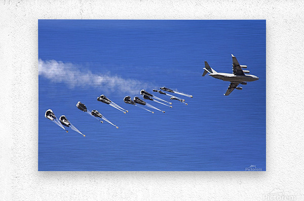 A C-17 Globemaster ejects a supply load of pallets during Operation Koranai Permakhtag.  Metal print