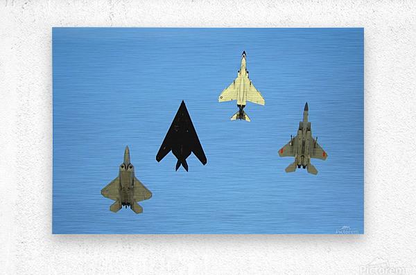 An F-22 Raptor an F-117 Nighthawk an F-4 Phantom and an F-15 Eagle in flight.  Metal print