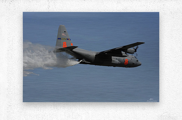 A U.S. Air Force C-130 Hercules releases its payload of water during training over South Carolina.  Metal print
