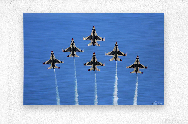 The U.S. Air Force Thunderbirds perform a 6-ship formation flyby during an air show.  Metal print