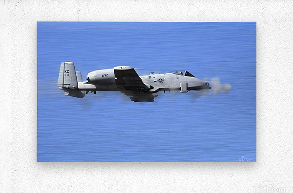 A pilot in an A-10 Thunderbolt II fires the planes 30-mm cannon.  Metal print