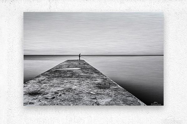 Fisherman angling at sunset  Metal print