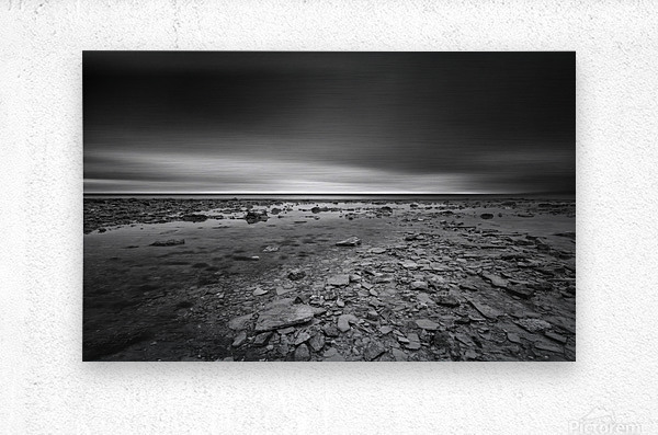 Dramatic sunset at a small bay and rocky beach  Metal print