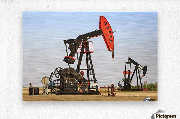 Oil well pump jacks at Bakken Oil Field near Estevan; Saskatchewan, Canada  Metal print