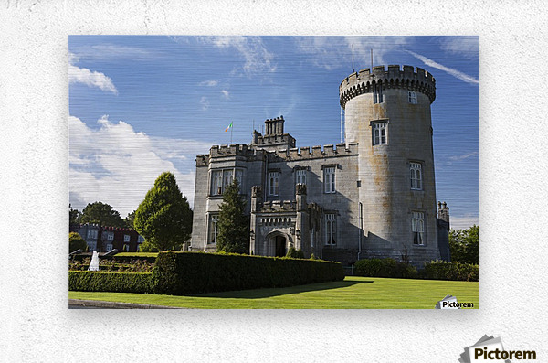 Stone castle with turret, manicured grass, gardens, fountain, blue sky and clouds; County Clare, Ireland  Metal print