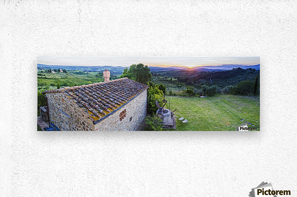 A stone house and a view of the lush landscape at sunset, Villa Capanuccia; Florence, Italy  Metal print