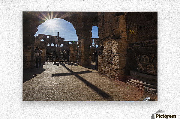 Sunburst through an archway at the Colosseum and a shadow of a cross; Rome, Italy  Metal print