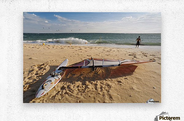 A Man On The Beach With His Windsurfing Board; Tarifa, Cadiz, Andalusia, Spain  Metal print