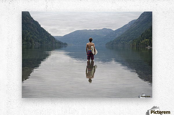 A Young Man Wearing A Swimsuit Stands In Cameron Lake; British Columbia Canada  Metal print