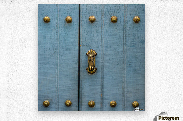A Blue Door With Brass Decorative Knobs; Cusco, Peru  Metal print