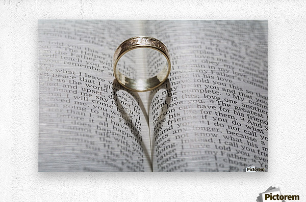 Close up of a gold ring with the shadow of an heart on book about love;Calgary Alberta Canada  Metal print
