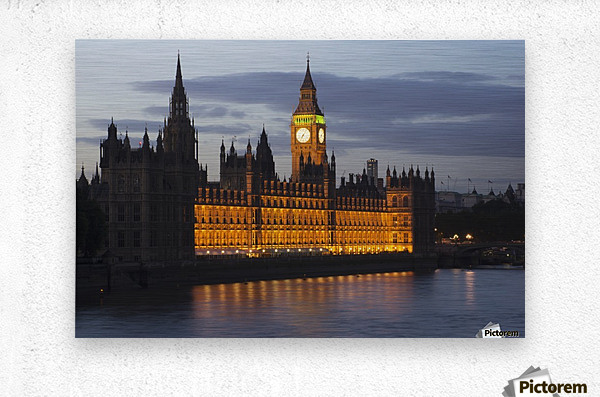 A Building And Clock Tower Along The Water's Edge Illuminated At Dusk; London, England  Metal print