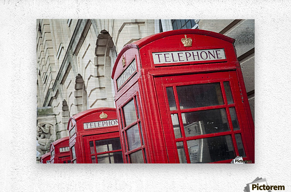 Telephone boxes in a row; Blackpool, Lancashire, England  Impression metal