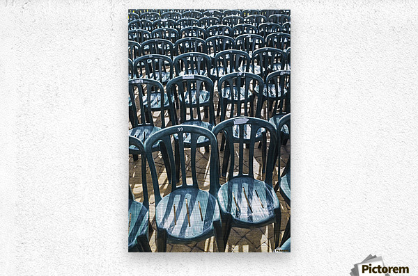 Plastic green chairs lined up in rows; Malaga Province, Andalusia, Spain  Metal print