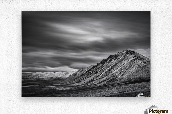 Brushed metal print black and white long exposure of clouds over the cloudy range along the dempster highway