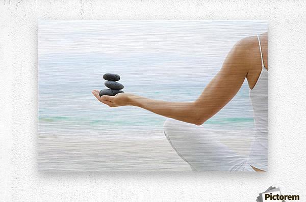 Hawaii, Woman Holding Stack Of Stones In Hands, Ocean In Background.  Metal print