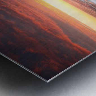 Sunset over rocky coastline Metal print
