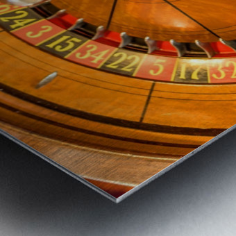 Round, wooden roulette wheel with numbers around the wheel Metal print