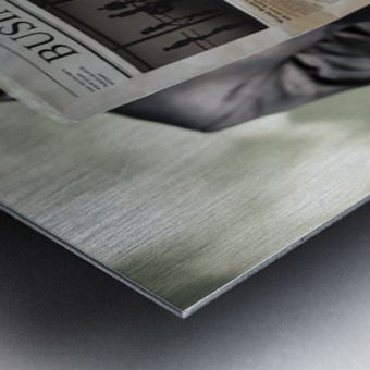 A bearded man reading the business section of a newspaper Metal print