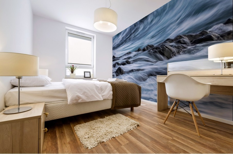 Long exposure of waves striking the coastline and flowing over rocks; Iceland Mural print
