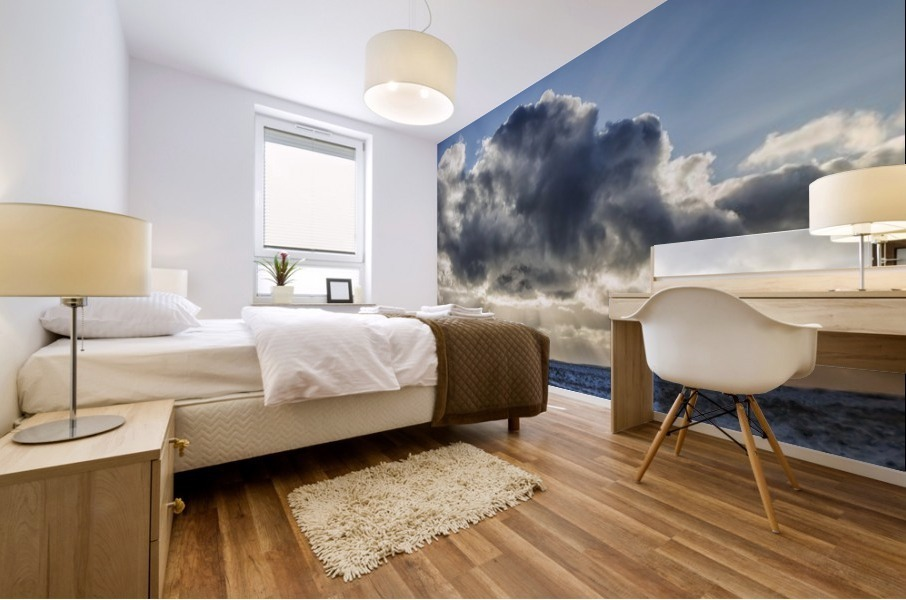 Rays of light shine out from behind the clouds in the skies above a lightnouse along the southern shore of Iceland; Iceland Mural print