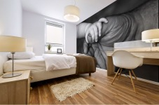Baby's Hand Holding On To Adult Hand Mural print
