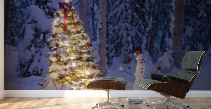 snowman with santa hat hanging ornaments on a christmas tree in a