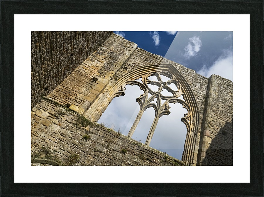 Stone facade and decorative window of a ruined building; North ...