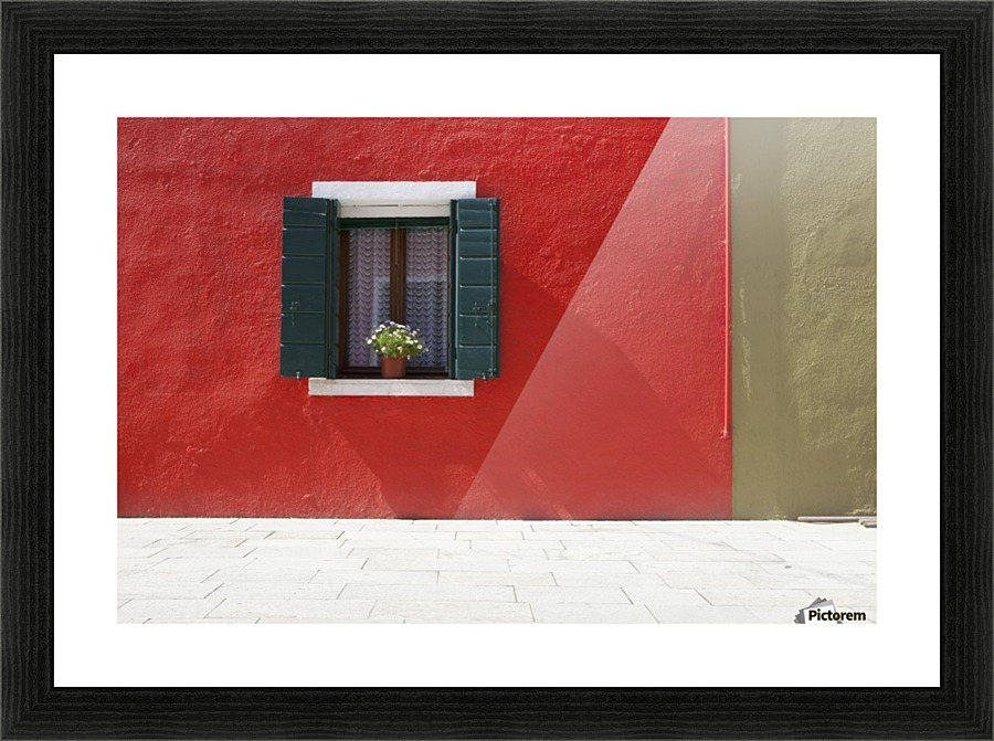 A flower pot sits in a window with shutters open in building painted a flower pot sits in a window with shutters open in building painted bright red sisterspd