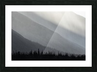 Light shines through the rain as it falls on the mountains along the Wind River in the Peel Watershed; Yukon, Canada Picture Frame print