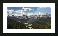 Panorama of river valley and mountain range with blue sky and clouds; Bragg Creek, Alberta, Canada Picture Frame print