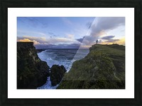 Person standing on a cliff face while the Atlantic Ocean pounds the shores beneath them; Iceland Picture Frame print