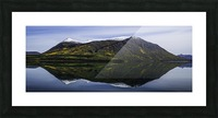 Reflection of the mountains surrounding Carcross reflected in the still waters; Yukon, Canada Picture Frame print