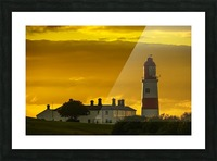 Souter Lighthouse under a glowing golden sky at sunset; South Shields, Tyne and Wear, England Picture Frame print