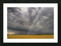 Dark storm clouds over a farm field; Whitburn, Tyne and Wear, England Picture Frame print