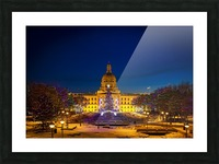 Alberta Legislature building illuminated and a Christmas tree with colourful lights on the trees for decoration at Christmas time; Edmonton, Alberta, Canada Picture Frame print