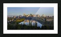 Skyline of downtown Edmonton reflected in the North Saskatchewan River under a blue sky; Edmonton, Alberta, Canada Picture Frame print