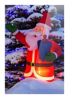 Glowing inflated Santa Claus Christmas decoration with Christmas lights on a snow covered evergreen tree; Calgary, Alberta, Canada Picture Frame print