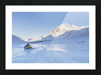 Native youth riding Snowmachine on overflow ice, Inukpasugruk (Giant) Creek, Anaktuvuk Pass, Gates of the Arctic National Park, Brooks Range, Northern Alaska, USA. Picture Frame print