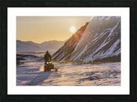 Man riding a snowmachine up the Anaktuvuk River Valley at sunset, Gates of the Arctic National Park, Brooks Range, Arctic Alaska Picture Frame print
