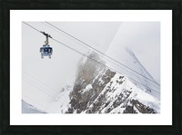 Scenic view of the Titlis Rotair revolving circular tram at Engelberg Resort in Switzerland Picture Frame print