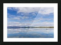 Light clouds reflect on the calm water of Tikchik Lake at the Tikchik Narrows Lodge, Wood Tikchik State Park, Southwestern Alaska; Alaska, United States of America Picture Frame print