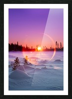 Sun flare glowing over a winter landscape; Trapper Creek, Alaska, United States of America Picture Frame print