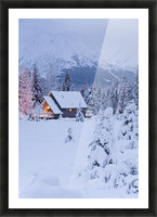 Snowcovered Home In A Wintry Meadow At Dawn With Inside Lights On, Girdwood, Southcentral Alaska Picture Frame print