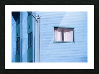 vintage blue wood building with window and electric pole Picture Frame print
