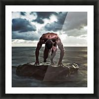 A muscular man in the starting position on a wet rock in the water;Tarifa cadiz andalusia spain Picture Frame print