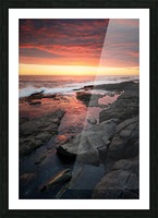 Sunset over rocky coastline Picture Frame print