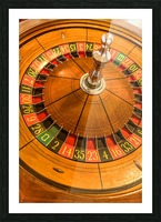 Round, wooden roulette wheel with numbers around the wheel Picture Frame print