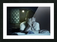 scared and sleepless boy chewing fingernails Picture Frame print