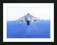 An AV-8B Harrier jet launches off the flight deck of USS Peleliu. Picture Frame print